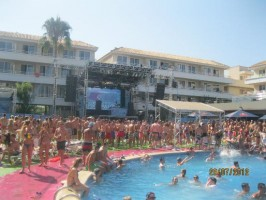 Kiss FM's Justin Wilkes on stage at the Kiss pool party at Mallorca Rocks hotel